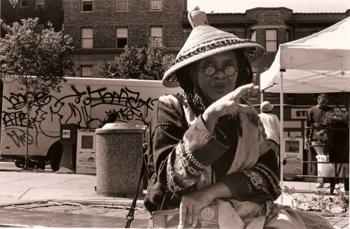 photo of a lady wearing a straw hat
