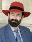 photo of Raymond Tallis wearing a red hat